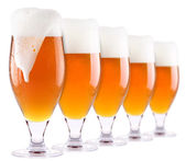 Frosty fresh beer collection with foam isolated — Stock Photo