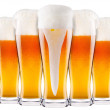 Stock Photo: Frosty fresh beer collection with foam isolated