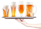 Beer on a silver tray with waitress hand — Stock Photo