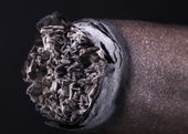 Macro of Cigar over black background — Stock Photo