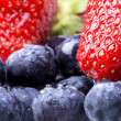 Stock Photo: Blue berrie, strawberry background