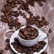 White cup of espresso full of coffee beans — Stock Photo #26185003