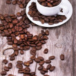 White cup of espresso full of coffee beans — Stock Photo #26251823