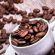 White cup of espresso full of coffee beans — Stock Photo #26311127