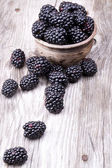 Blackberries on wooden table — Stock Photo