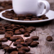 White cup of espresso full of coffee beans — Stock Photo #26425265