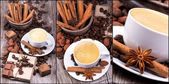 Coffee with Chocolate bar and spices — Stock Photo