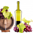 Grapes on a barrel with corkscrew and wine glass — Photo