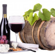 Grapes on a barrel with corkscrew, wine glass and cheese — Stock fotografie