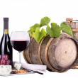 Royalty-Free Stock Photo: Grapes on a barrel with corkscrew, wine glass and cheese