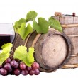 Grapes with wine glass and wooden vintage barrel — Stock Photo
