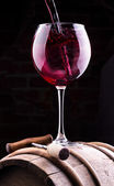 Splash red wine against a black background — Stock Photo