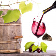 Stock Photo: Grapes on a barrel with corkscrew, butterfly and wine glass