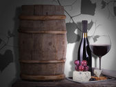 Grapes on a barrel with corkscrew, wine glass and cheese — Stock Photo
