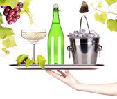 Grapes, ice bucket with champagne on a tray — Stock Photo