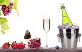 Summer fruits and ice bucket with champagne — Stock Photo