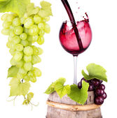 Grapes and wine glass on a wooden vintage barrel — Stock Photo
