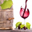 Red wine, glass and barrel with grapes — Stock Photo
