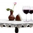 Wine glasses with flower on a table — Stockfoto