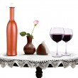 Glass of  wine and a bottle with flower — Stock Photo