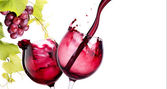 Pair of glass with red wine splash — Stock Photo