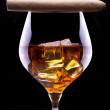 Cognac and Cigar on black — Stock Photo