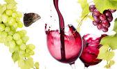 Coppia di vetro con una spruzzata di vino rosso — Foto Stock