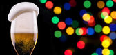 Frosty glass of light beer on party background — Stock Photo