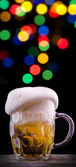 Frosty glass of light beer on party background — Foto de Stock