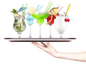 Alcoholic cocktail set on a tray with hand — Stock Photo