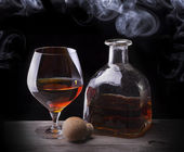Cognac glass shrouded in a smoke — Stock Photo