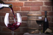 Glass of wine against a brick wall — Stock Photo