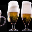 Frosty glass of light beer on black background — Stock Photo