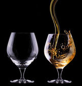 Cognac or brandy full and empty glass — Stock Photo