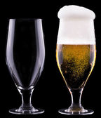 Full and empty glass of light beer — Stock Photo