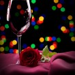 Glass of wine and rose on black — Stock Photo #34942067