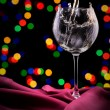 Glass of wine on red silk — Stock Photo