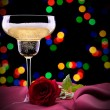 Glass of champagne and rose on black — Stock Photo