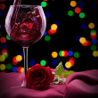 Glass of wine and rose on black — Stock Photo