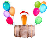 Beer with hat of Santa and balloons — Stock Photo