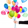 Flying balloons with Businessman hand — Stock Photo
