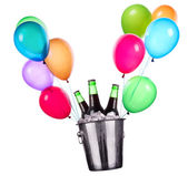 Beer bottles and flying balloons — Stock Photo
