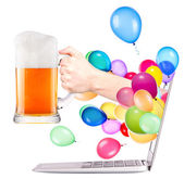 Hand with beer and laptop — Stock Photo