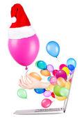 El ile bir balon ve dizüstü — Stok fotoğraf