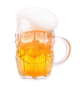 Frosty glass of light beer — Stock Photo