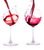 Splash red wine against a white background — Stock Photo