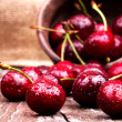 Stock Photo: Cherries on wooden table
