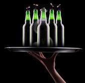 Open wet beer bottles — Stock Photo