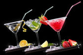 Alcohol cocktail set on a black — Stock Photo