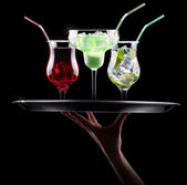Alcohol cocktail set on a waiter tray — Stock Photo